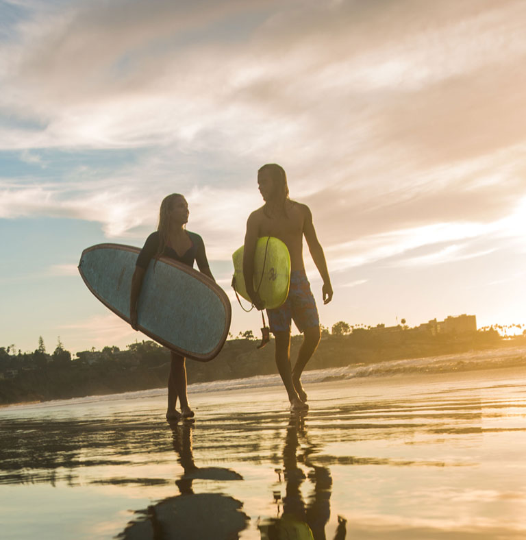 2 surfers walking along LaJolla Shores  | San Diego CA
