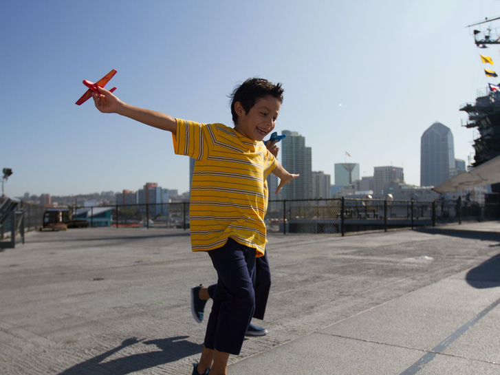 Kid enjoying some edutainment aboard the USS Midway Museum