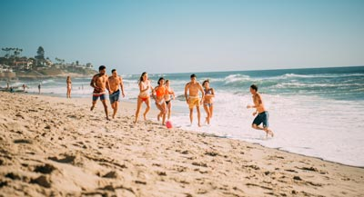 Group playing soccer on the beach in San Diego - Top May Events