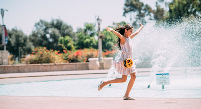 Tween running around the Bea Evenson Fountain on Balboa Park