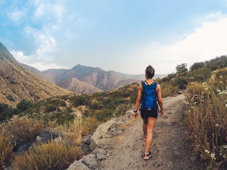 Woman hiking Cedar Creek in San Diego
