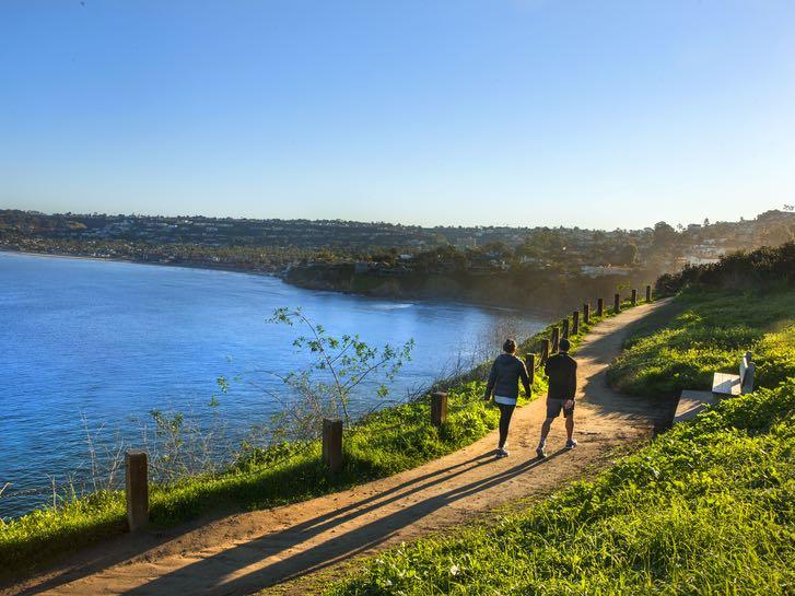 Couple walking along a trail in La Jolla