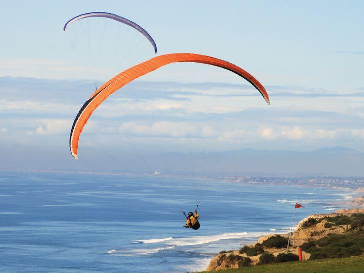 Paraglider over Torrey Pines in San Diego