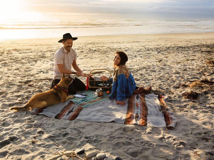 Couple having a picnic on the beach