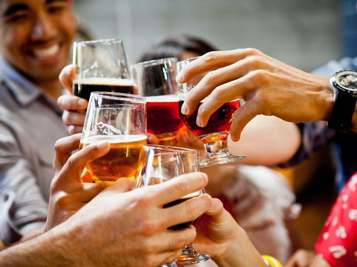 Toasting tasters of local craft beer