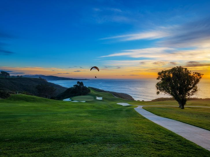 Sunset and paraglider over Torrey Pines Golf Course