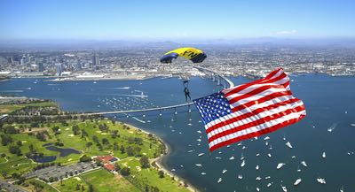 Skydiver with American Flag over San Diego