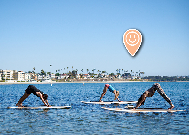 Paddleboarders doing yoga
