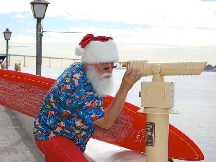 Surfer dressed as Santa in San Diego CA