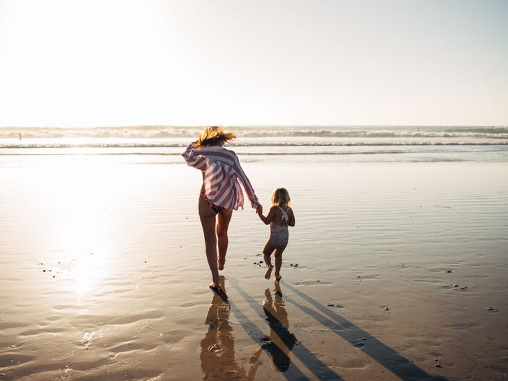 Mother and Daughter at the beach in San Diego
