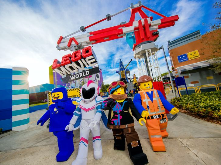 LEGO Movie characters in front of THE LEGO MOVIE WORLD