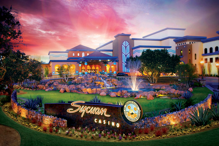 exterior view of sycuan casino featuring grass and plants