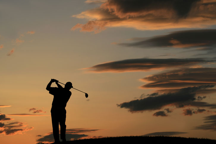 golfer sillhouette with clouds