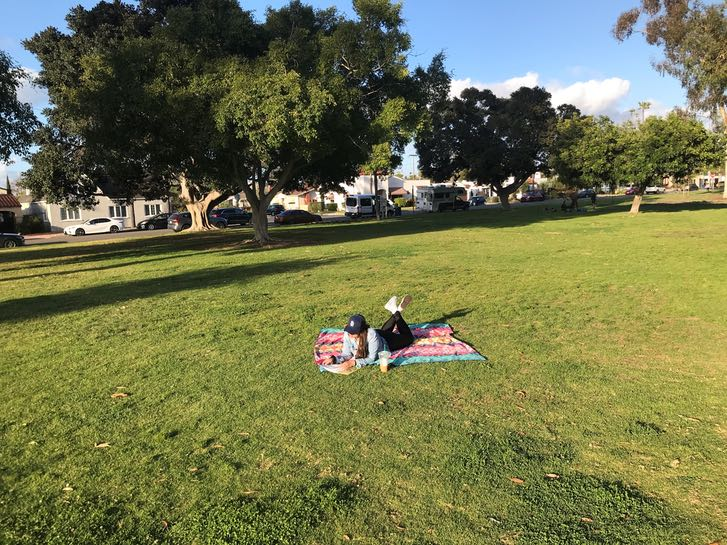 Woman having a picnic at Morley Field