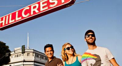 3 San Diegan's under the Hillcrest sign