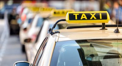 Tops of taxi cab cars waiting in a line