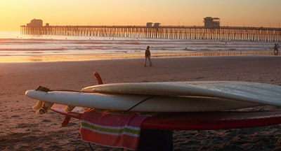 Oceanside CA pier surfboards stacked at sunset