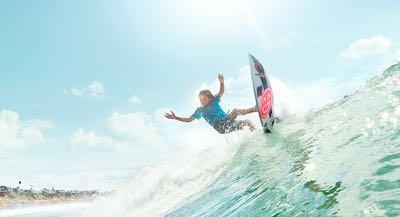 Surfing a wave in San Diego CA